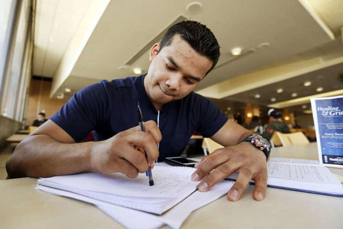 FILE — Kevin Reyes studies at Salt Lake Community College in Salt Lake City, Thursday, March 5, 2015. For the first time, new students at the college can enroll in a condensed eight-week semester for an expanded array of courses this year.