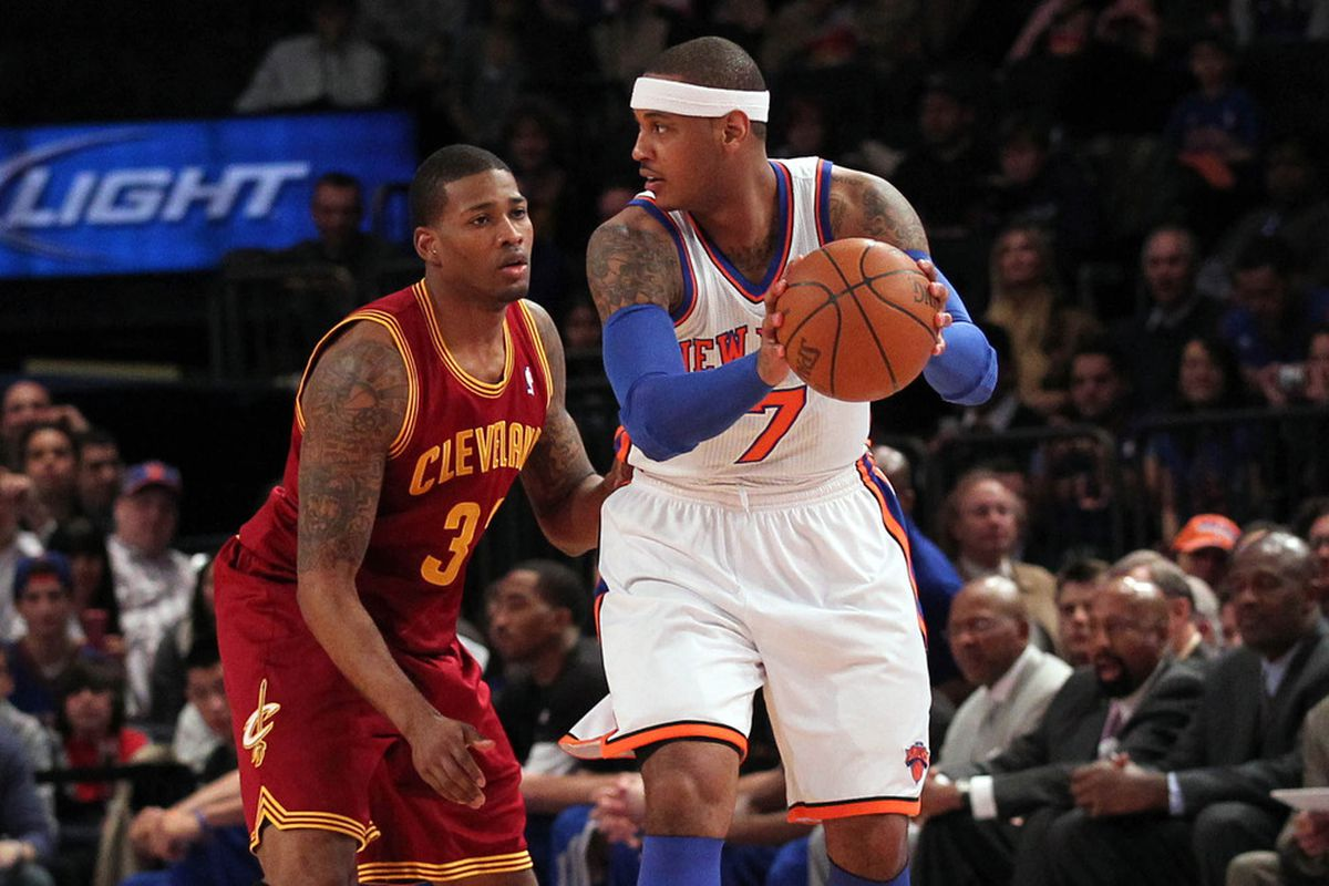 Mar 31, 2012; New York, NY, USA;   Cleveland Cavaliers small forward Alonzo Gee (33) defends New York Knicks small forward Carmelo Anthony (7) during the first quarter at Madison Square Garden.  Mandatory Credit: Anthony Gruppuso-US PRESSWIRE