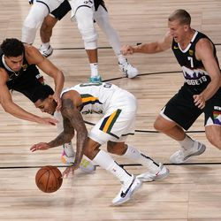 Denver Nuggets' Michael Porter Jr., left, and Mason Plumlee (7) combine to strip the ball away from Utah Jazz's Jordan Clarkson (00) during the second half an NBA first round playoff basketball game, Tuesday, Sept. 1, 2020, in Lake Buena Vista, Fla.