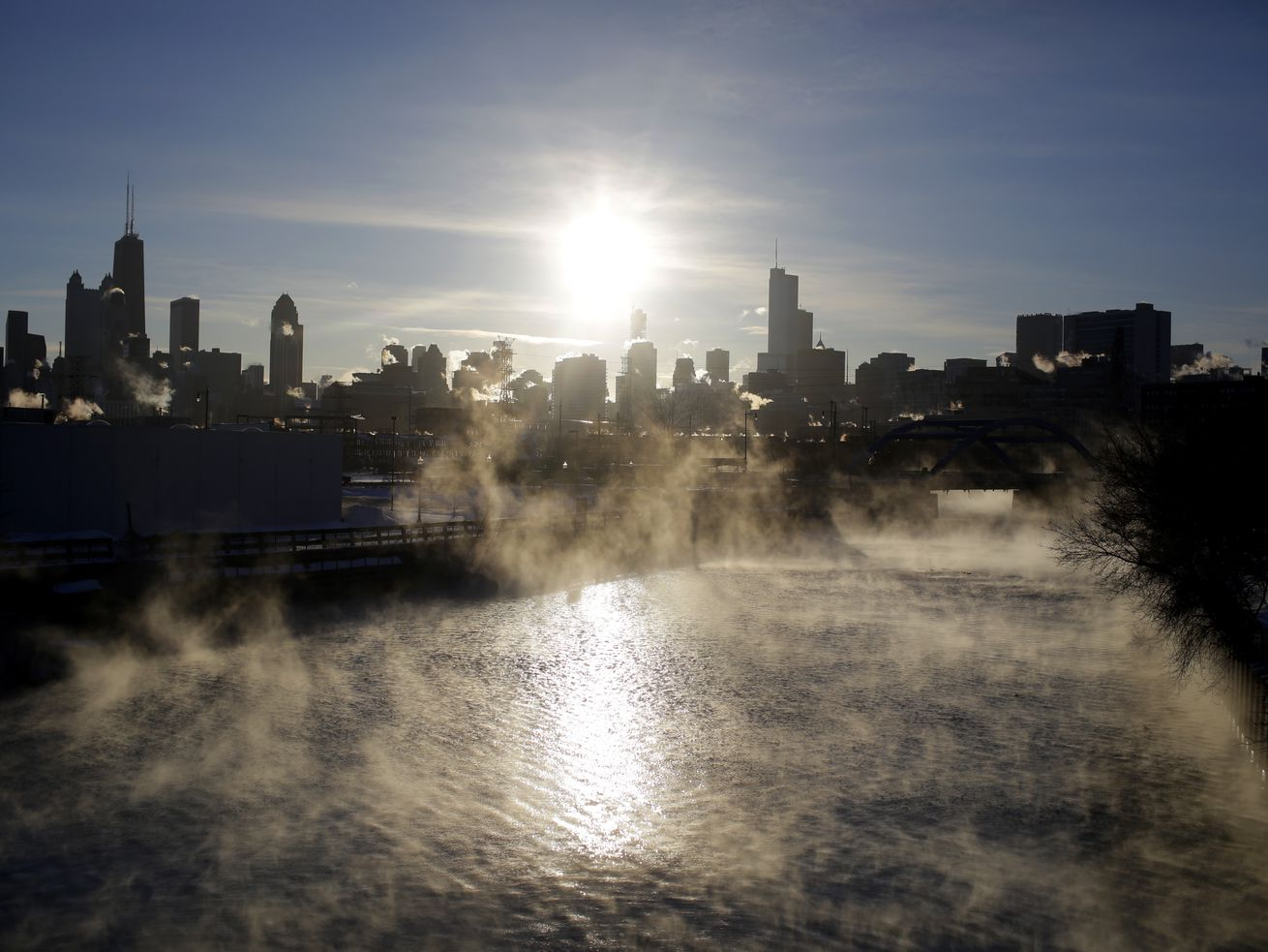 Steam rises above the Chicago River as temperatures dropped to 22 below zero on January 30, 2019.