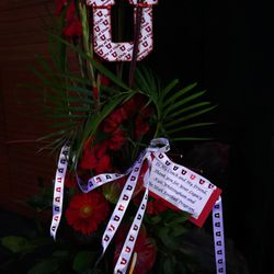 A bouquet of flowers from the University of Utah football team is on display at a public memorial service for former BYU football coach LaVell Edwards at the Provo Convention Center on Friday, Jan. 6, 2017.