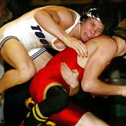Tooele's Andrew Hochstrasser, top, works on pinning Huricane's Kurt McMahon to take the 3A State Wrestling Championship at UVSC. photo by Dan Lund 02/14/04 (Submission date: 02/15/2004)
