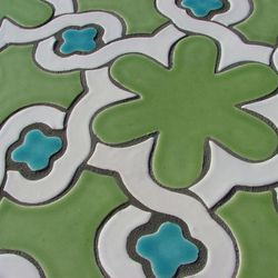 This undated publicity image provided by Mediterra Tile shows a Daisy Chain Mosaic ceramic tile.