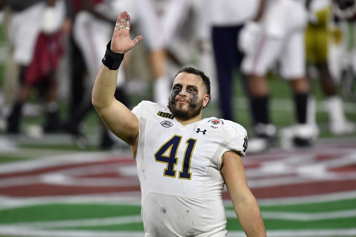 Kurt Hinish #41 of the Notre Dame Fighting Irish waves to the fans after the College Football Playoff Semifinal at the Rose Bowl football game against the Alabama Crimson Tide at AT&T Stadium on January 01, 2021 in Arlington, Texas.