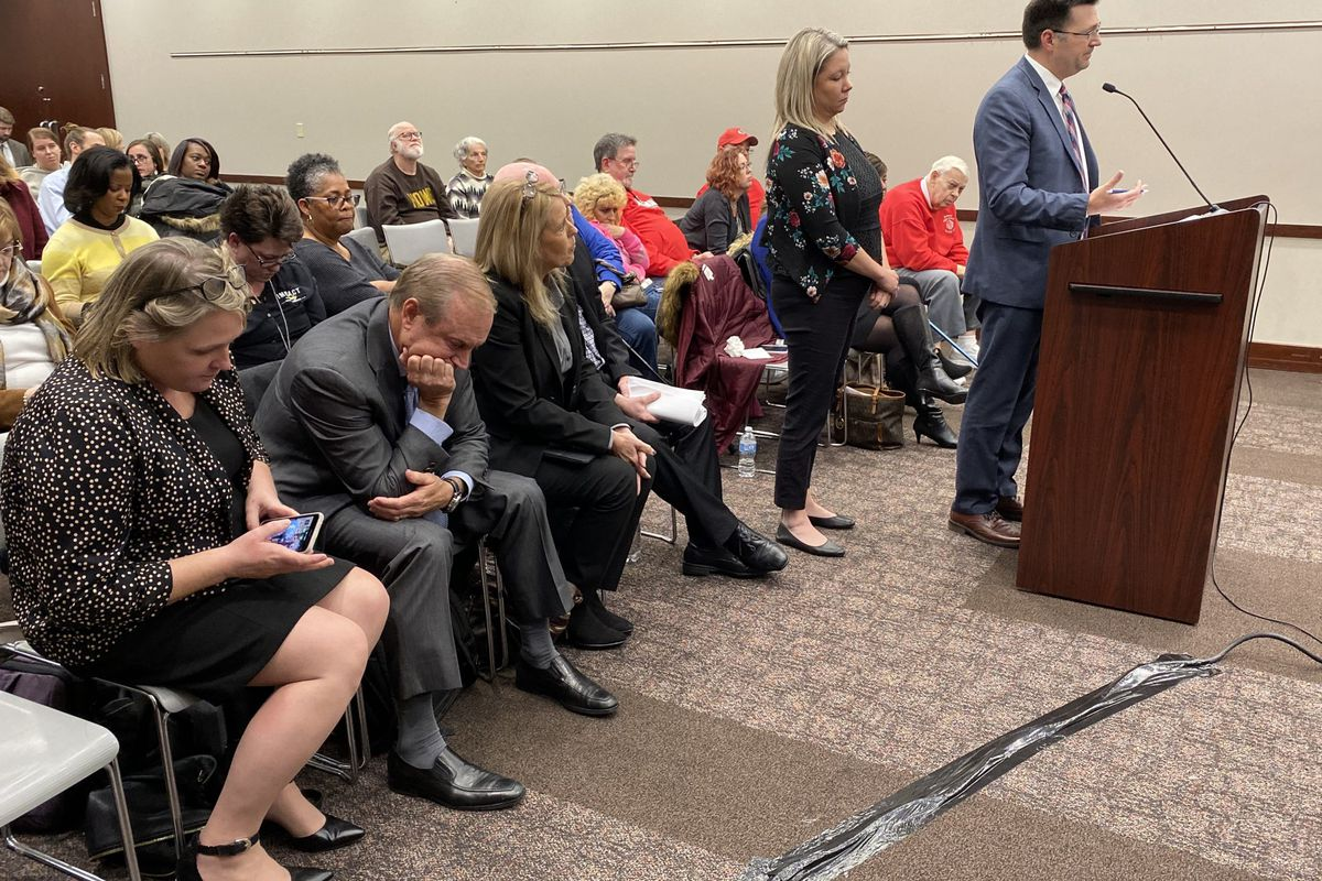 Charter Schools USA CEO Jon Hage, second from left, listens to discussion about the charter application for Howe High School on Friday, Dec. 13, 2019.