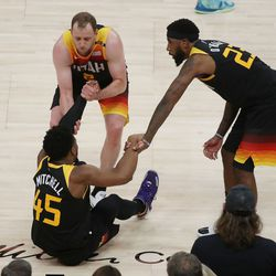 Utah Jazz guard Donovan Mitchell (45) is helped up after falling during the NBA playoffs in Salt Lake City on Thursday, June 10, 2021. The Jazz won 117-111.