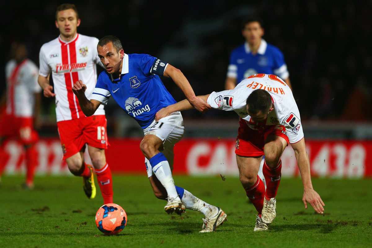Leon Osman competes for the ball during Everton's Fourth Round win at Stevenage.
