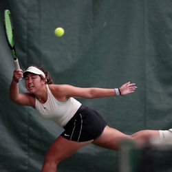 Highland's Dylan Lolofie hits the ball as she battles Sage Bergeson of Woods Cross for the 5A tennis state championship at Salt Lake Tennis & Health Club on Saturday, Oct. 9, 2021.
