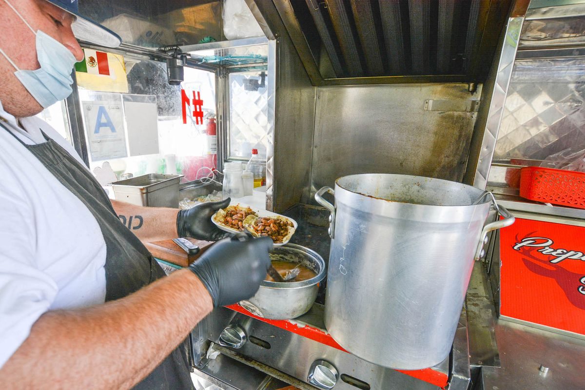 Walter Soto from El Ruso making tacos from his trailer.