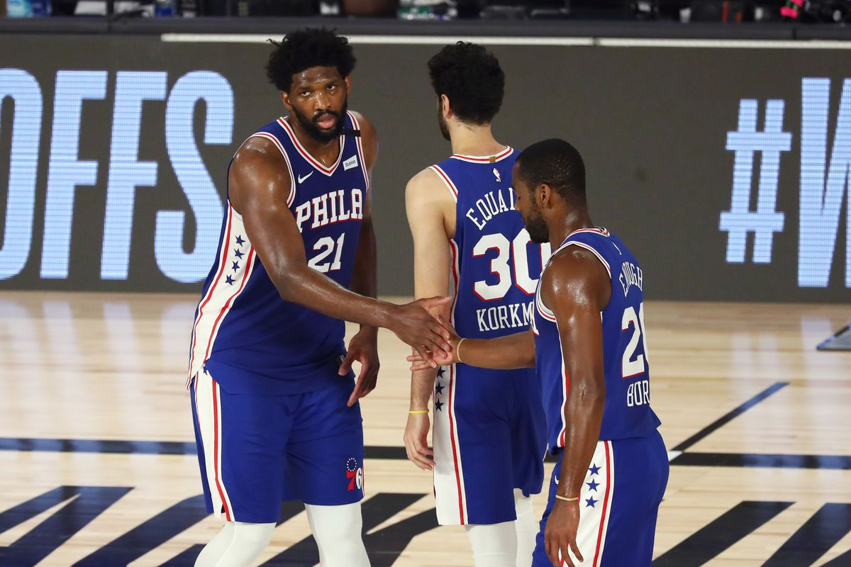 Philadelphia 76ers center Joel Embiid (21) and forward guard Alec Burks (20) and guard Furkan Korkmaz (30) react during the second quarter against the Boston Celtics in game four of an NBA basketball first-round playoff series at The Field House.