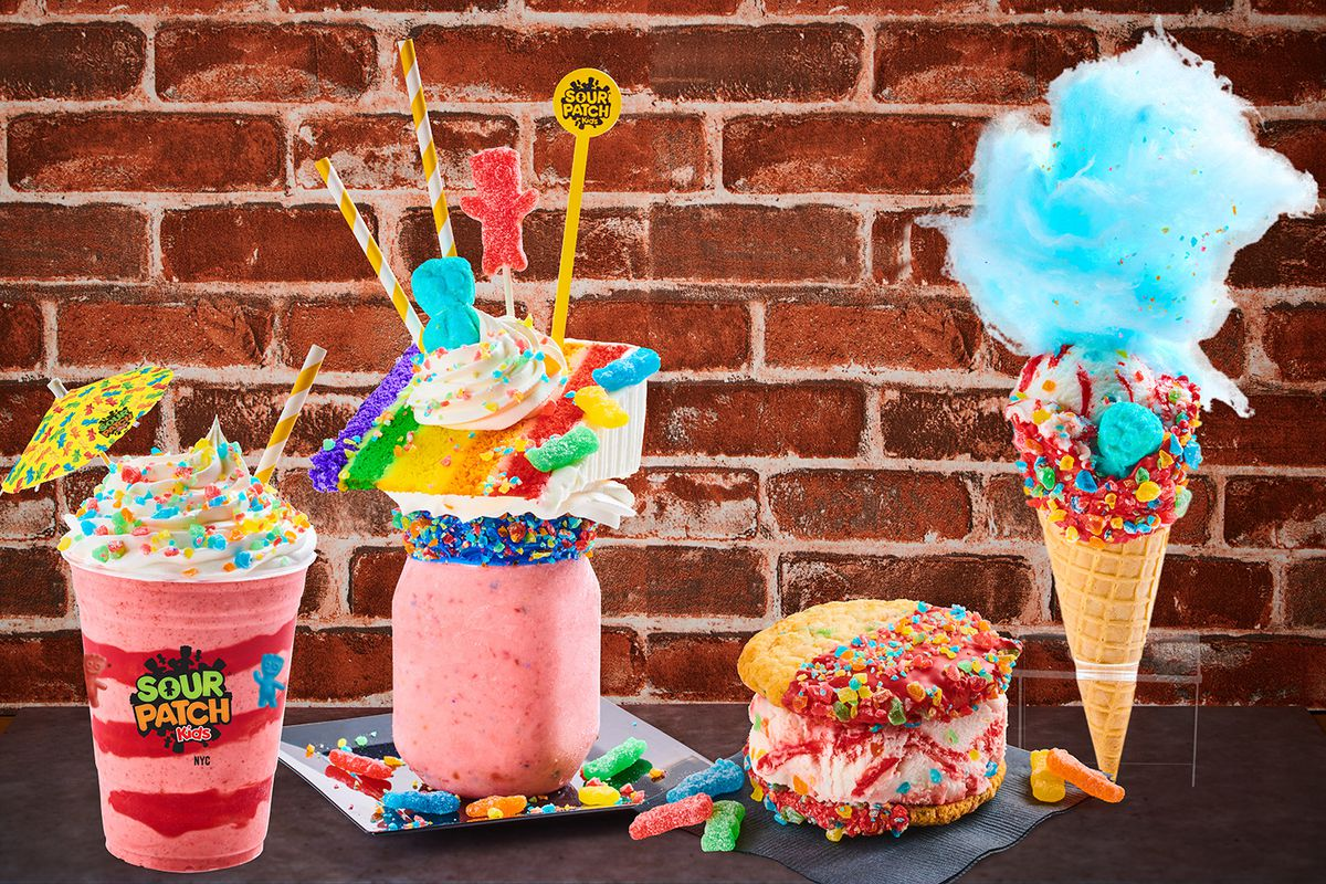 An assortment of colorful, candy-themed desserts, dipped in candy and topped with Sour Patch Kids branded straws and umbrellas