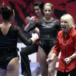 Co-Head Coach Megan Marsden cheers for Stephanie McAllister, left, after her beam routine at the NCAA Salt Lake Regional Gymnastics Saturday, April 7, 2012 in Salt Lake City.