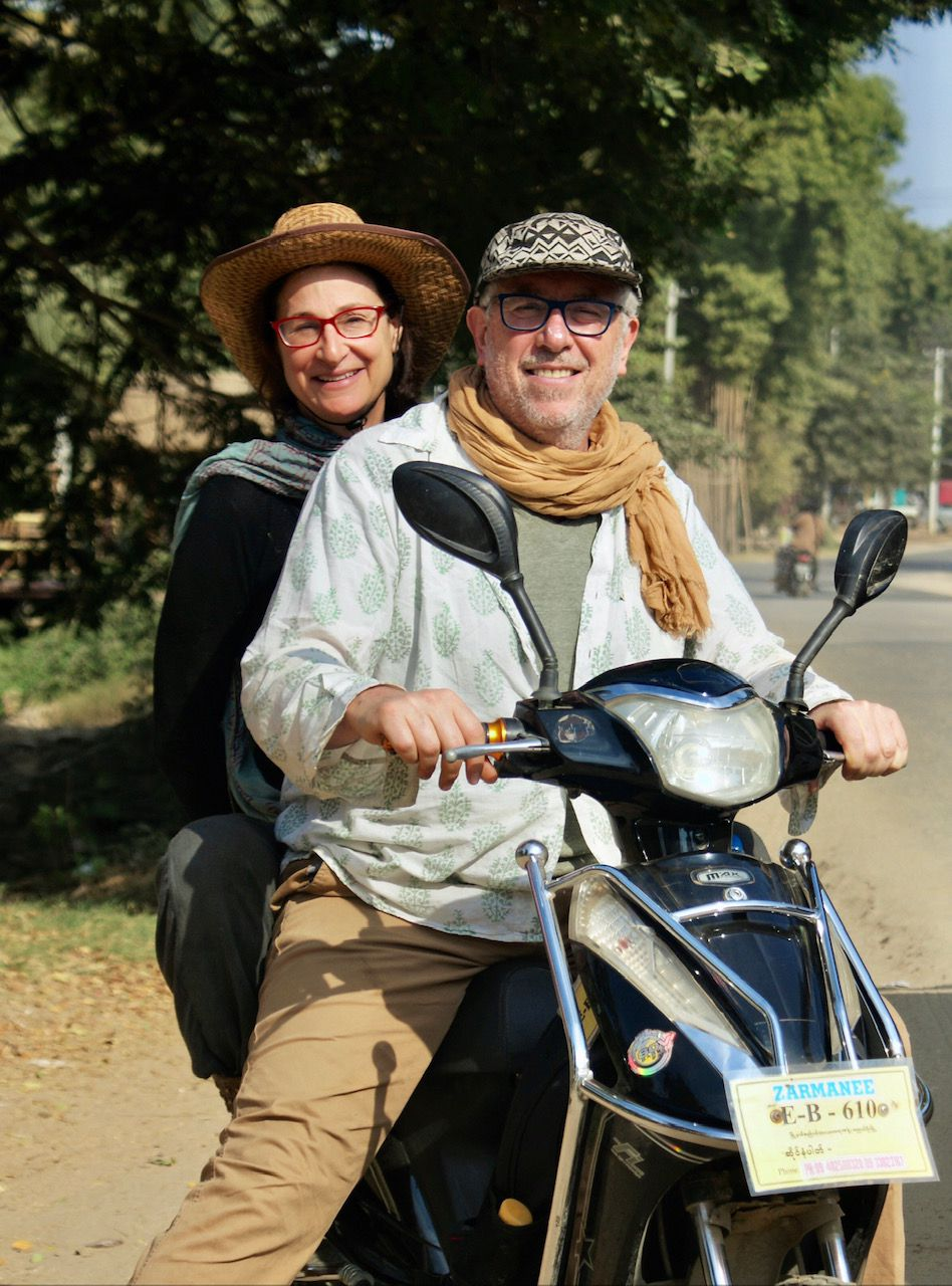 Ben Sandzer-Bell and Peta Kaplan traveling several years ago in Asia on a motorbike.