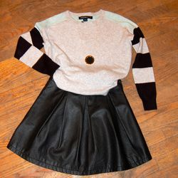 <b>French Connection</b> Grey Multi Sweater, $138; <b>French Connection</b> Black Perforated Skirt, $138; <b>House of Harlow 1960</b> Black Starburst Necklace, $58