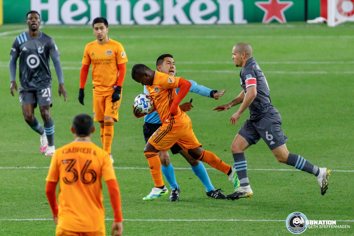 October 18, 2020 - Saint Paul, Minnesota, United States - Minnesota United midfielder Osvaldo Alonso (6) chases after Houston Dynamo forward Darwin Quintero (23) after an altercation between the two during the match at Allianz Field.