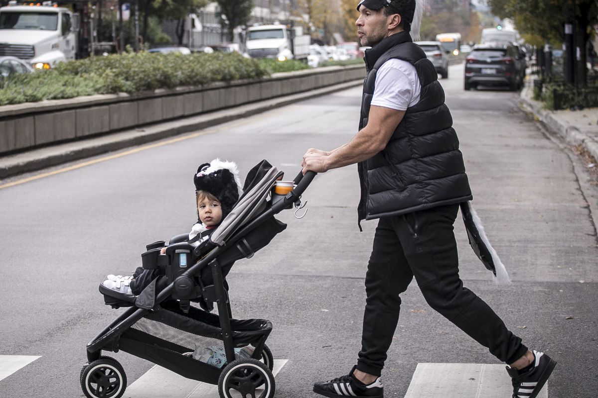 A young trick-or-treater gets a push through the West Loop neighborhood in October 2019.