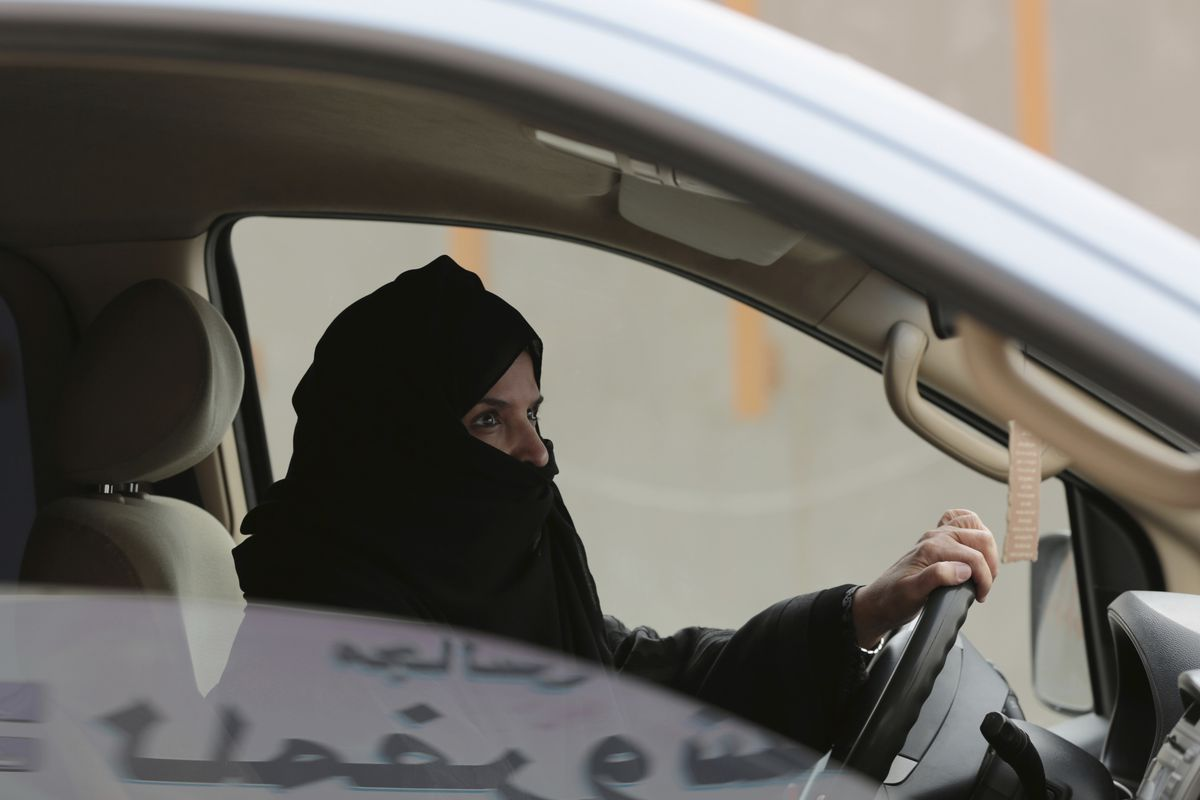 FILE - In this March 29, 2014 file photo, Aziza al-Yousef drives a car on a highway in Riyadh, Saudi Arabia, as part of a campaign to defy Saudi Arabia's then ban on women driving. Nearly a dozen Saudi women's rights activists, most of them imprisoned, ha