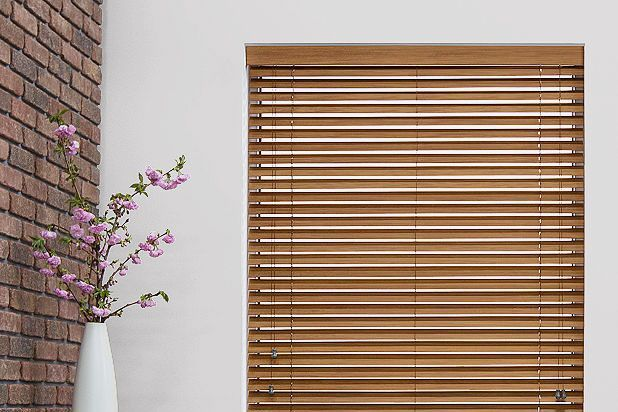 Window with brown bamboo blinds.
