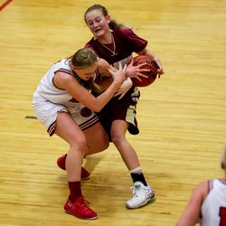 Maple Mountain's Kaylee Radford tries to strip the ball from Springville's Kayla Jackson, left, in a girls basketball game in Springville on Tuesday, Jan. 26, 2021.