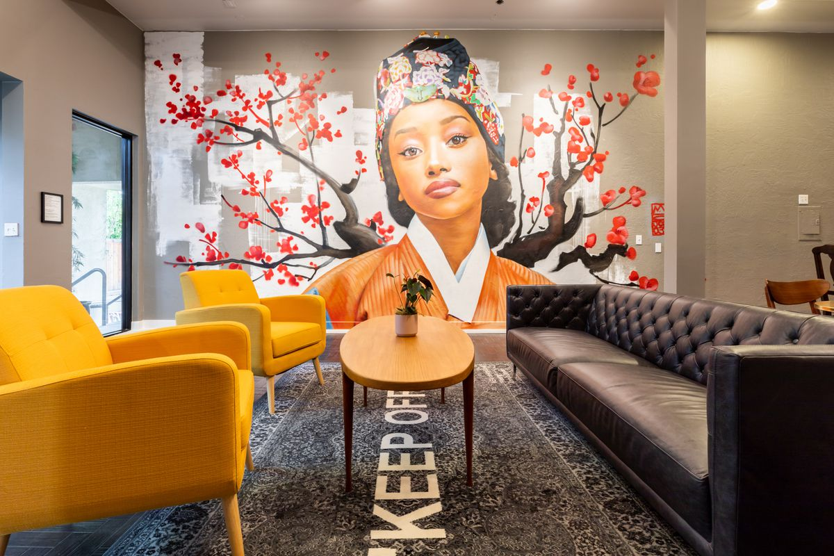 A mural of a black woman in traditional Korean dress at a new cafe in Berkeley