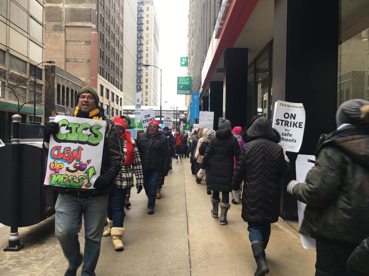 Teachers and supporters march in front of Chicago International Charter Schools' corporate offices on the fifth day of the strike.