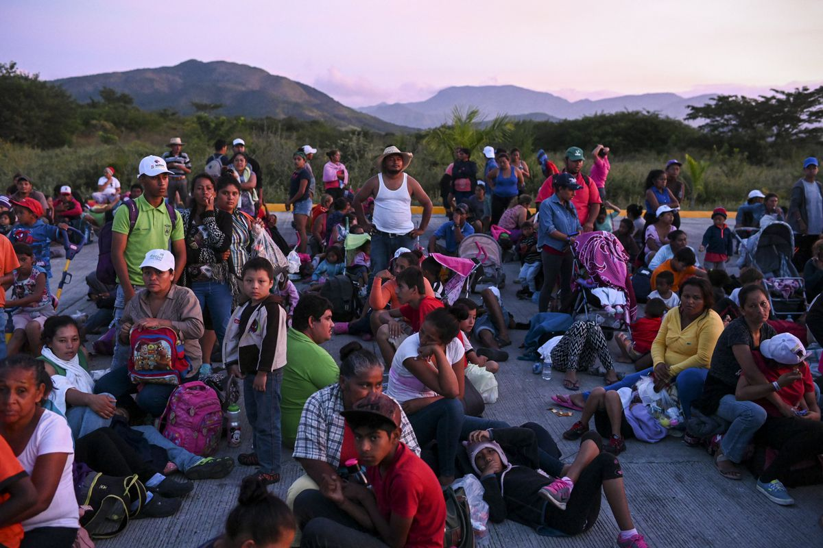 October 30: Thousands of migrants traveling towards the US border rest at a gas station in Santiago Niltepec, Mexico Read More. Read More.  (Carolyn Van Houten/The Washington Post via Getty Images)