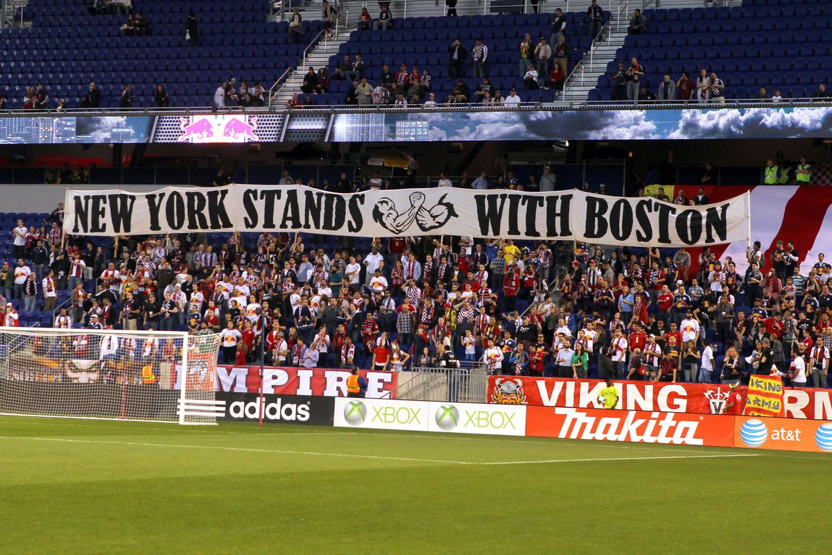 The banner that Revolution and Red Bulls SGs will carry onto the field on Saturday.