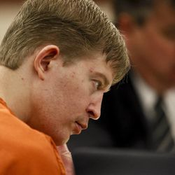 Matthew David Stewart looks at state's evidence during the third day of his preliminary hearing at 2nd District Courthouse in Ogden on Friday, Nov. 2, 2012.