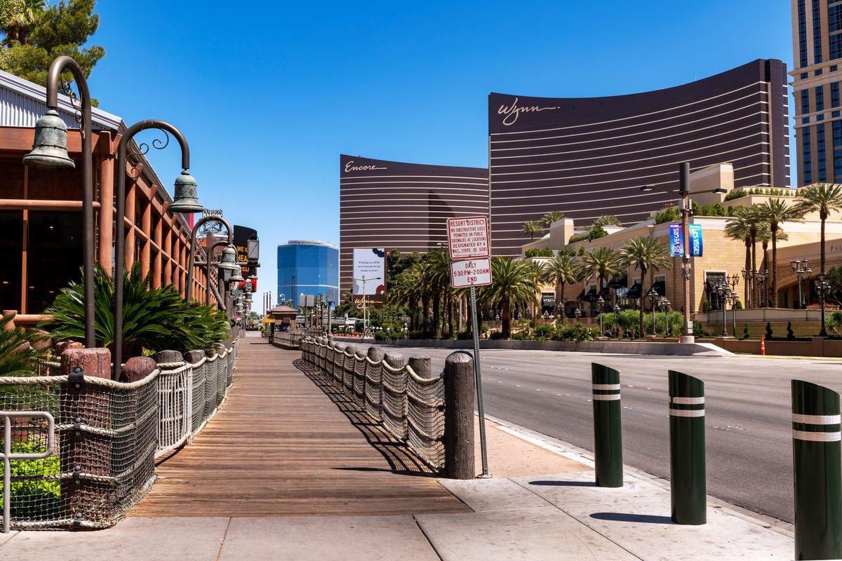 The sidewalk in front of Treasure Island, looking at Wynn Las Vegas and Encore Las Vegas