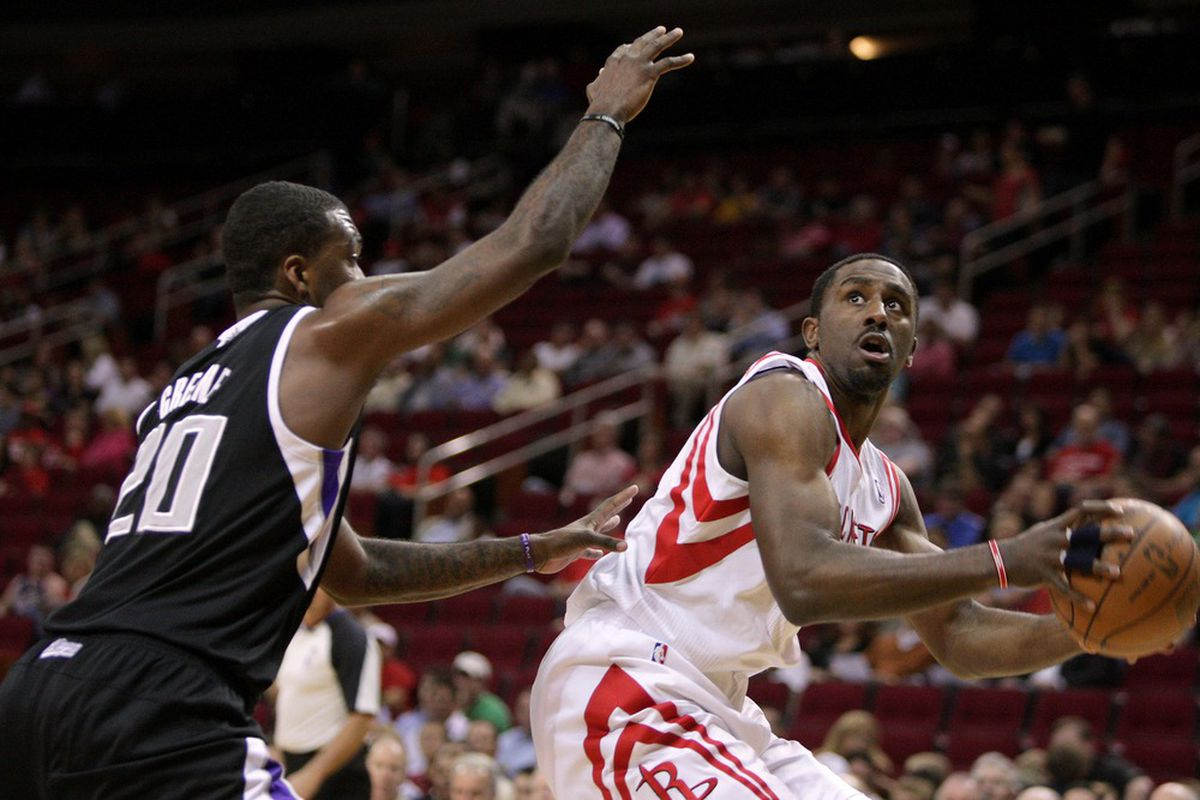 March 26, 2012; Houston, TX, USA; Houston Rockets forward Patrick Patterson (54) controls the ball during the first quarter against the Sacramento Kings at the Toyota Center. Mandatory Credit: Troy Taormina-US PRESSWIRE
