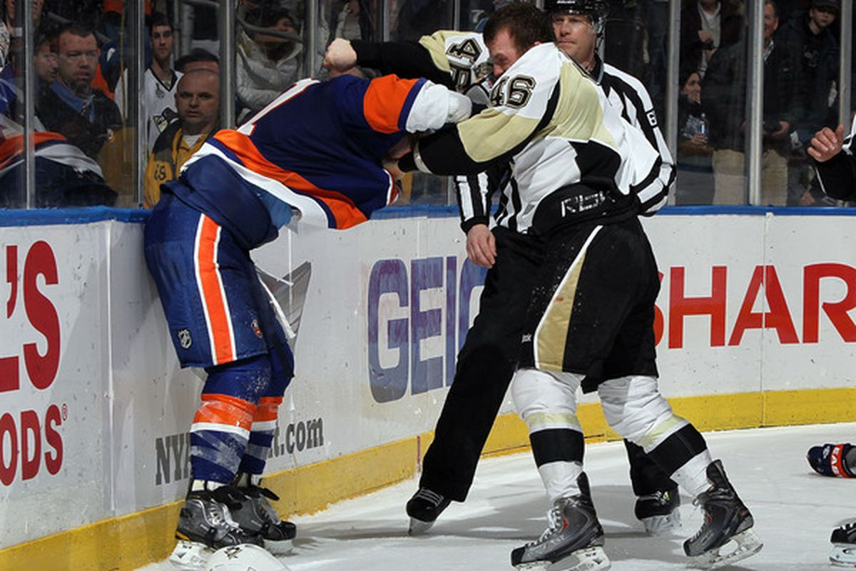 Joe Vitale of the Pittsburgh Penguins fights Andrew MacDonald of the New York Islanders during the third period at Nassau Coliseum in Uniondale New York. The Isles defeated the Pens 9-3.  (Photo by Jim McIsaac/Getty Images)