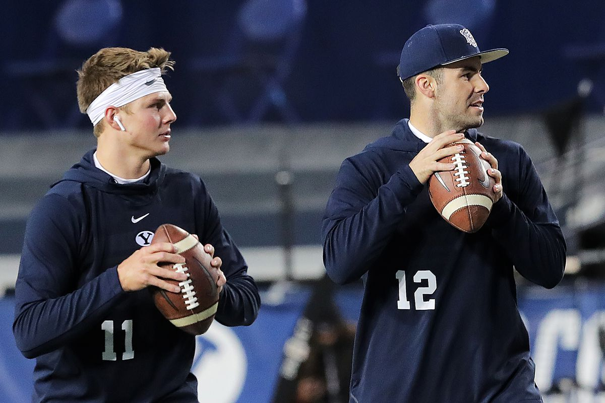 Brigham Young Cougars quarterback Zach Wilson (11), who is making his first start, gets warmed up with teammate Brigham Young Cougars quarterback Tanner Mangum (12) as BYU and Hawaii prepare to play at LaVell Edwards Stadium in Provo on Saturday, Oct. 13,