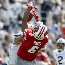 Brigham Young Cougars defensive back Micah Hannemann (7) breaks up a pass intended for Wisconsin Badgers wide receiver Danny Davis III (6) at LaVell Edwards Stadium in Provo on Saturday, Sept. 16, 2017.
