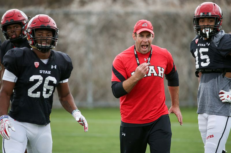 Utah defensive coordinator Morgan Scalley works with players during a practice at their outdoor practice facility in Salt Lake City on Tuesday, April 10, 2018.