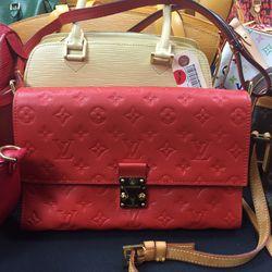 Louis Vuitton purse, $1,912
