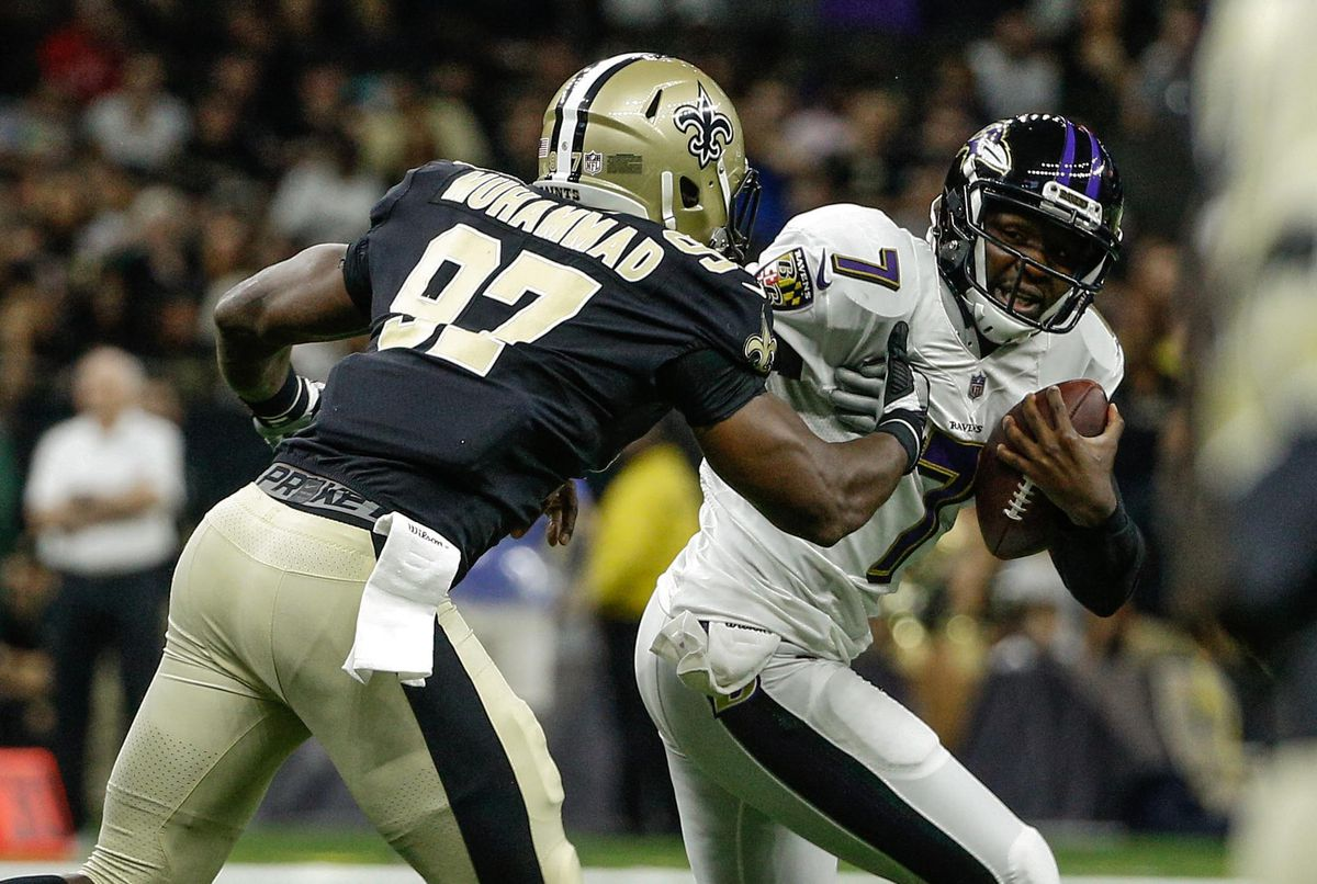 New Orleans, LA, USA; New Orleans Saints defensive end Al-Quadin  Muhammad (97) sacks and forces a fumble from Baltimore Ravens  quarterback Thaddeus Lewis (7)  during the first half of a preseason  game at the Mercedes-Benz Superdome.