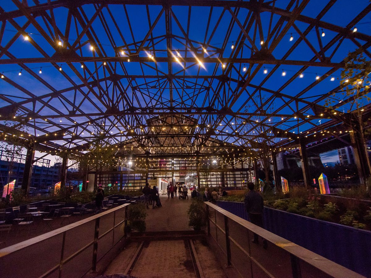 An outdoor area in Philadelphia with lights and an arched skylight.