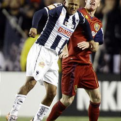 Nat Borchers (right) of Real Salt Lake fights for control of the ball against Humberto Suazo from the Rayados of Monterrey during the final game of the CONCACAF championship at Rio Tinto Stadium in Sandy Wednesday, April 27, 2011.