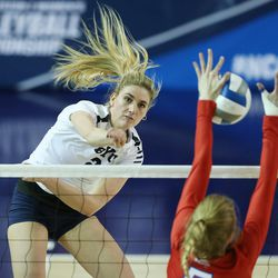 BYU's Cosy Burnett hits against American's Shannon Webb during the NCAA tournament in Provo on Friday, Dec. 1, 2017.