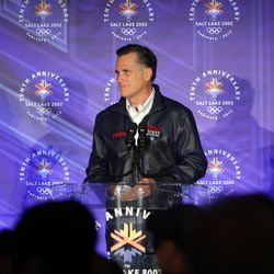 Mitt  Romney  speaks  with 2002 SLOC volunteers and staff members at the Grand Hall in Salt Lake City  Saturday, Feb. 18, 2012. Fraser Bullock and Ann Romney applaud.