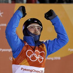 Jonathon Lillis, of the United States, reacts to his score during the men's aerial final at Phoenix Snow Park at the 2018 Winter Olympics in Pyeongchang, South Korea, Sunday, Feb. 18, 2018. (AP Photo/Kin Cheung)