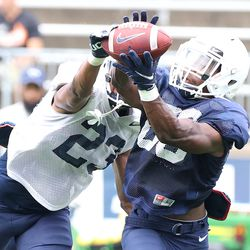 UConn's Juan Rosario #23 tries to break up a pass to Kevens Clercius #86 during the Huskies open practice at Pratt & Whitney Stadium at Rentschler Field in East Hartford, CT on Saturday, August 14, 2021.