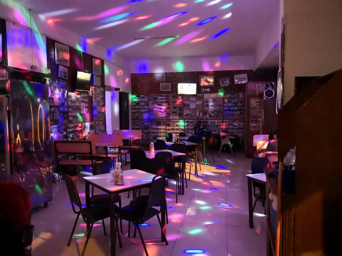 A bar interior highlighted with disco lights