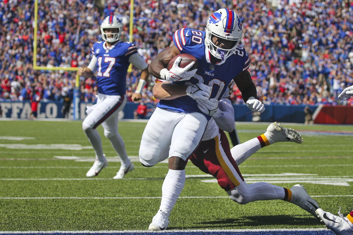 Buffalo Bills running back Zack Moss runs past Washington Football Team's Cole Holcomb for a touchdown.