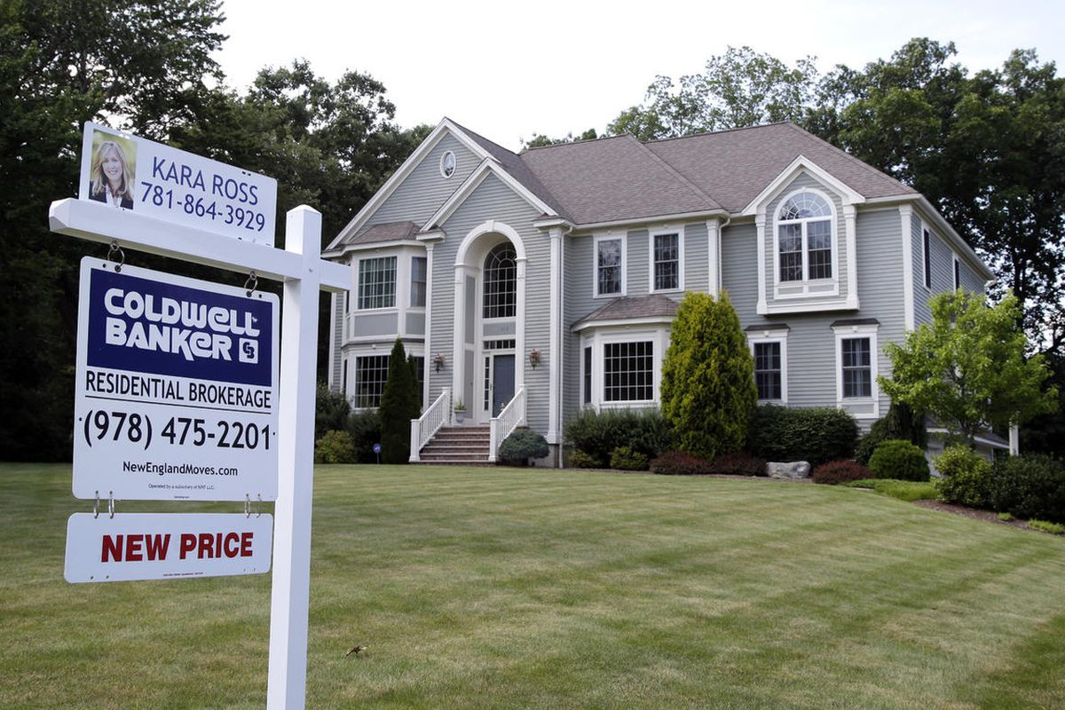 This Monday, July 10, 2017, photo shows a house for sale, in North Andover, Mass.