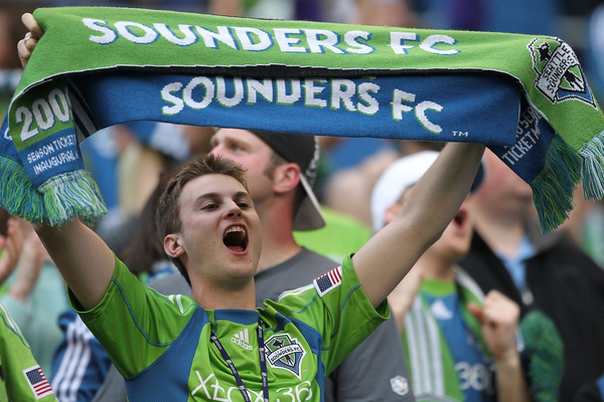 SEATTLE - JUNE 05:  Seattle fan stretches his vocal cords in preparation for travel to Portland. (Photo by Otto Greule Jr/Getty Images)
