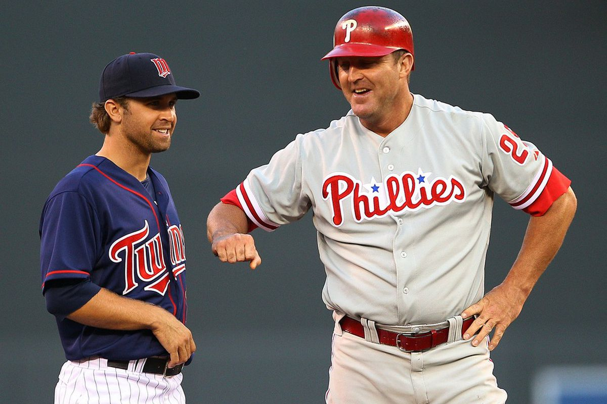 Twins rookie Brian Dozier yuking it up with former Twin and all-around best-person-ever Jim Thome.