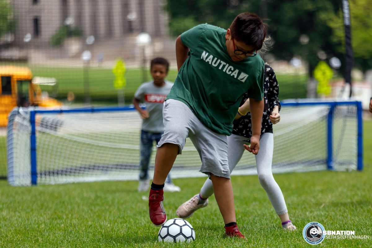 June 17, 2019 - Saint Paul, Minnesota, United States - Local kids from the Sanneh Foundation play soccer at the Allstate Day For Play event on the lawn of the Minnesota State Capitol.