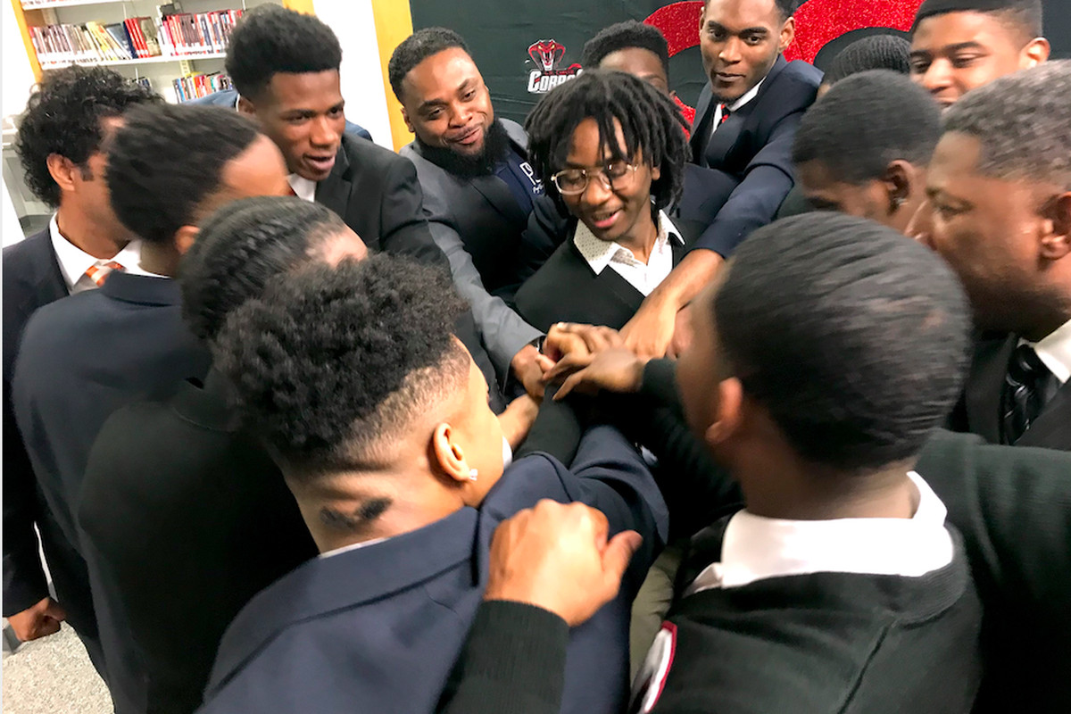 Members of the Brothers & Sisters Speaking Out For Change and their mentors huddle after presenting their recommendations to Shelby County Schools leaders.