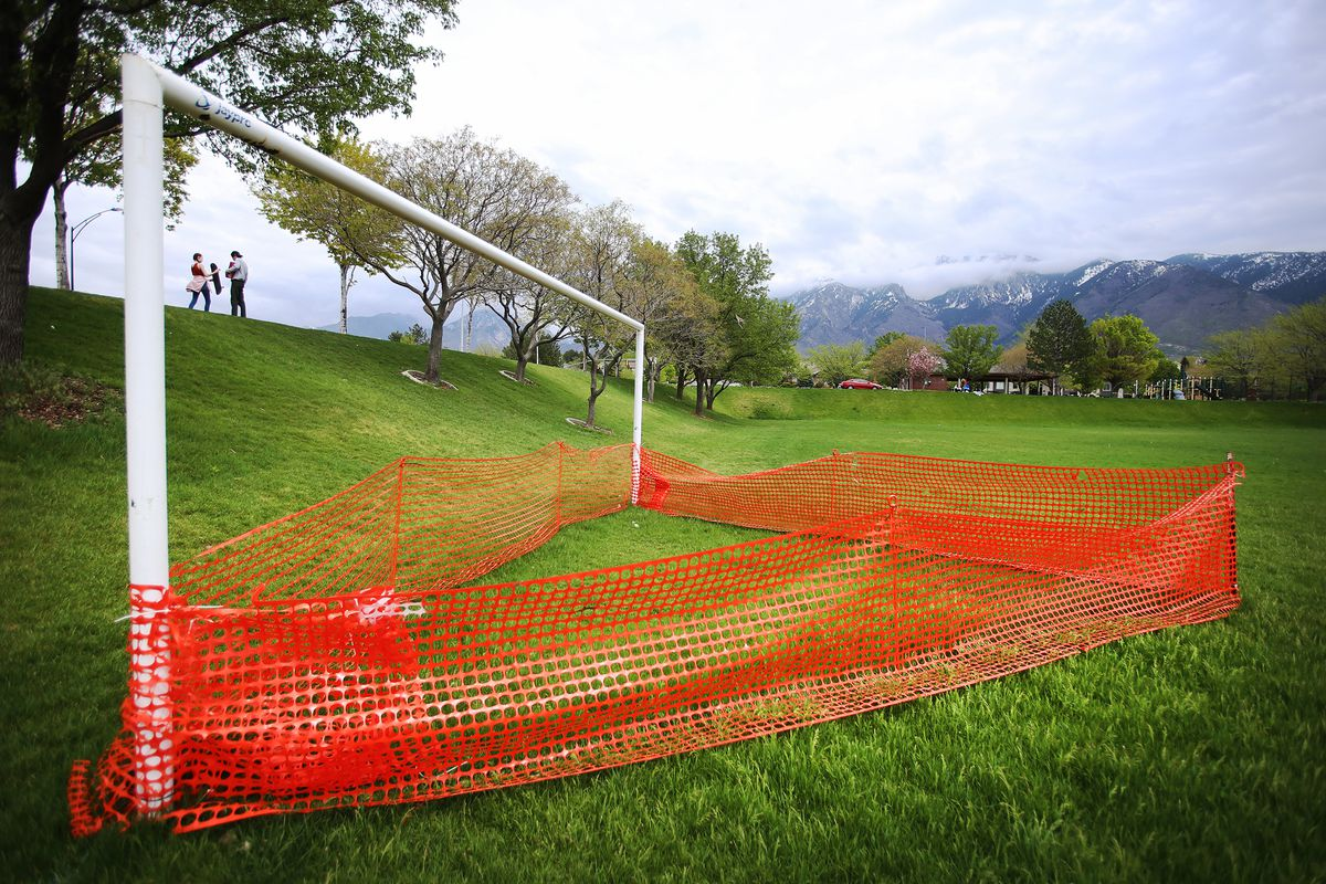 Orange netting surrounds the soccer goals at Storm Mountain Park in Sandy, on Friday, May 1, 2020.